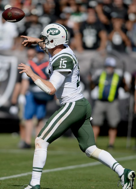 New York Jets quarterback Josh McCown (15) throws a pass in the second half as the New York Jets face the Oakland Raiders at Oakland Coliseum in Oakland, Calif., on Sunday, September 17, 2017.