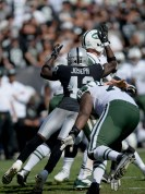 Oakland Raiders safety Karl Joseph (42) leaps for a strip sack in the second half as the New York Jets face the Oakland Raiders at Oakland Coliseum in Oakland, Calif., on Sunday, September 17, 2017.