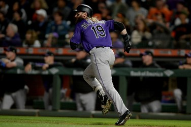 Colorado Rockies center fielder Charlie Blackmon (19) watches a two run double hit the center field wall in the second inning as the Colorado Rockies face the San Francisco Giants at AT&T Park in San Francisco, Calif., on Tuesday, September 19, 2017.