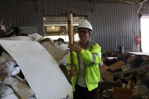 Curtis Reid Henderson holds up a bat he found in Recology's garbage pile.
