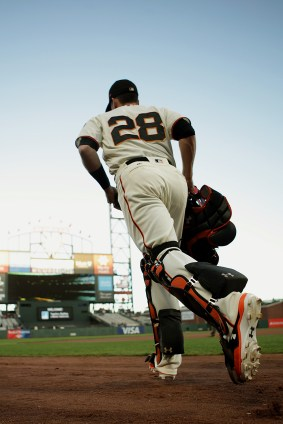 San Francisco Giants catcher Buster Posey (28) takes the field as the Colorado Rockies face the San Francisco Giants at AT&T Park in San Francisco, Calif., on Tuesday, September 19, 2017.