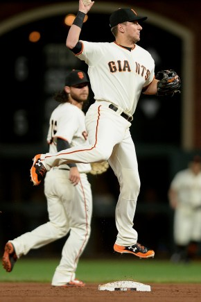 San Francisco Giants second baseman Joe Panik (12) turns two in the fifth inning as the Colorado Rockies face the San Francisco Giants at AT&T Park in San Francisco, Calif., on Tuesday, September 19, 2017.