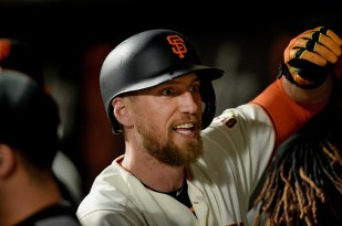 San Francisco Giants right fielder Hunter Pence (8) is congratulated after hitting a home run in the fifth inning as the Colorado Rockies face the San Francisco Giants at AT&T Park in San Francisco, Calif., on Tuesday, September 19, 2017.
