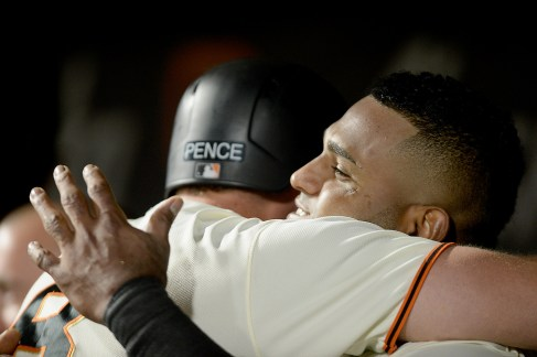 San Francisco Giants first baseman Pablo Sandoval (48) embraces right fielder Hunter Pence (8) after a two run homer in the fifth inning as the Colorado Rockies face the San Francisco Giants at AT&T Park in San Francisco, Calif., on Tuesday, September 19, 2017.