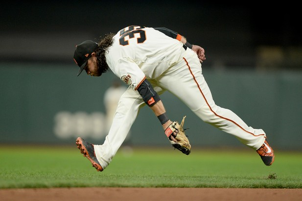 San Francisco Giants shortstop Brandon Crawford (35) keeps a Reynolds hit to the infield in the ninth inning as the Colorado Rockies face the San Francisco Giants at AT&T Park in San Francisco, Calif., on Tuesday, September 19, 2017.
