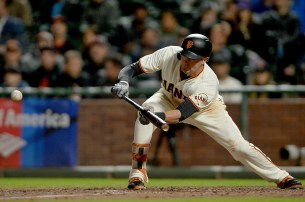 San Francisco Giants first baseman Ryder Jones (63) beats out an infield bunt in the ninth inning as the Colorado Rockies face the San Francisco Giants at AT&T Park in San Francisco, Calif., on Tuesday, September 19, 2017.