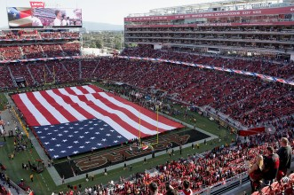 Fans stand during the National Anthem as the Los Angeles Rams face the San Francisco 49ers at Levi's Stadium in Santa Clara, Calif., on Thursday, September 21, 2017.