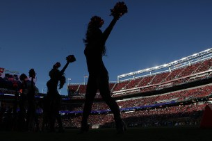 The Gold Rush cheer in the first half as the Los Angeles Rams face the San Francisco 49ers at Levi's Stadium in Santa Clara, Calif., on Thursday, September 21, 2017.