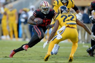 San Francisco 49ers' Carlos Hyde (28) runs upfield in the first half as the Los Angeles Rams face the San Francisco 49ers at Levi's Stadium in Santa Clara, Calif., on Thursday, September 21, 2017.