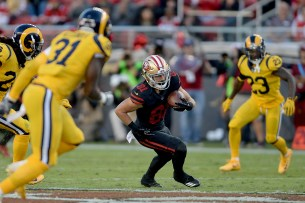 San Francisco 49ers' Trent Taylor (81) runs after a catch in the first half as the Los Angeles Rams face the San Francisco 49ers at Levi's Stadium in Santa Clara, Calif., on Thursday, September 21, 2017.