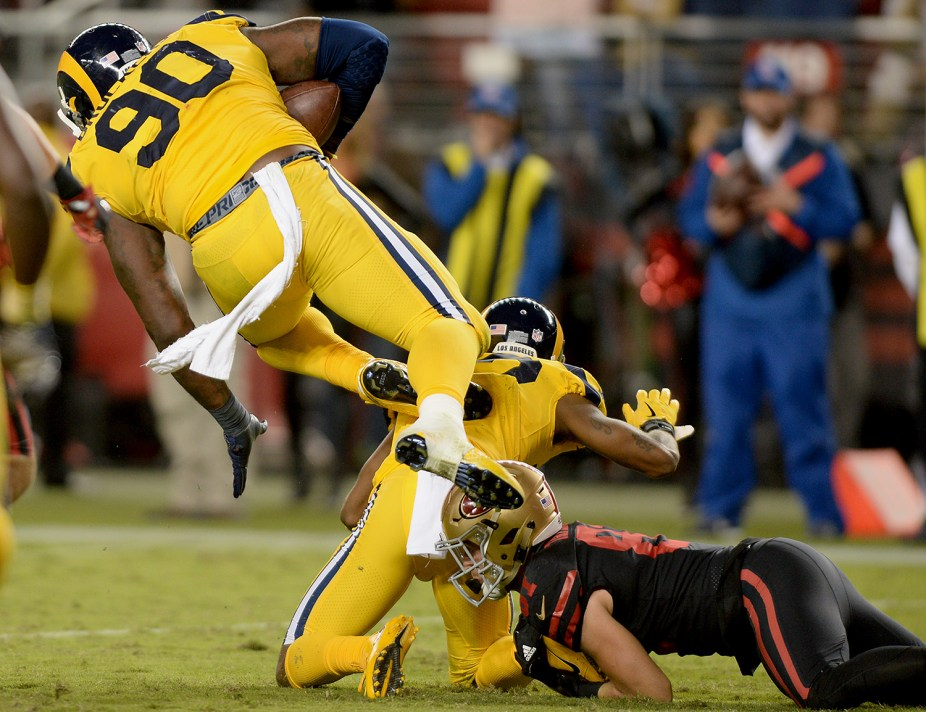 Los Angeles Rams defensive tackle Michael Brockers (90) intercepts the ball in the fourth quarter as the Los Angeles Rams face the San Francisco 49ers at Levi's Stadium in Santa Clara, Calif., on Thursday, September 21, 2017.