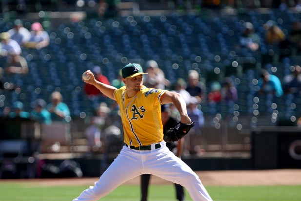 Oakland Athletics starting pitcher Kendall Graveman (49) pitches in the first inning as the Seattle Mariners take on the Oakland Athletics at the Oakland Coliseum on Wednesday, September 27, 2017.