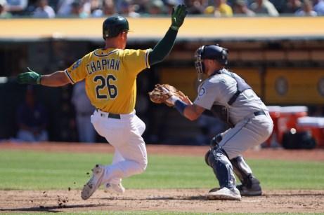 Oakland Athletics third baseman Matt Chapman (26) slides into home plate in the fourth inning as the Seattle Mariners take on the Oakland Athletics at the Oakland Coliseum on Wednesday, September 27, 2017.