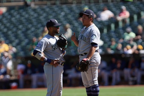 Seattle Mariners second baseman Robinson Canó (22) talk with Seattle Mariners pitcher Erasmo Ramirez (31) at the pitchers mound in the fourth inning as the Seattle Mariners take on the Oakland Athletics at the Oakland Coliseum on Wednesday, September 27, 2017.