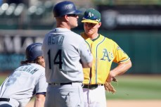 Oakland Athletics third baseman Matt Chapman (26), Seattle Mariners infielder Gordon Beckham (6) and Seattle Mariners outfielder Ben Gamel (16) wait at third base to get the results of the reviewed play as the Seattle Mariners take on the Oakland Athletics at the Oakland Coliseum on Wednesday, September 27, 2017. Athletics won 6-5.