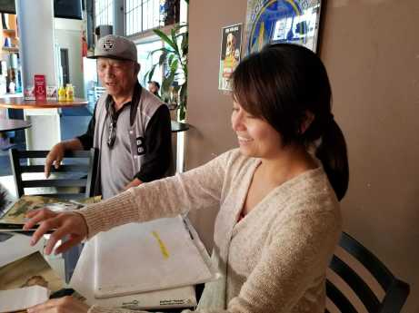 Benito Solis, 75, and Rejilyn Barles, 40, owner and co-manager of SB40, review documents and photographs during an afternoon break at the restaurant on Friday, Sept. 29, 2017 in San Francisco, Calif.