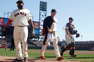 San Francisco Giants pitcher Matt Cain (18) San Francisco Giants first baseman Pablo Sandoval (48) and San Francisco Giants catcher Buster Posey (28) walk back to the dugout after pregame workouts before their game against the San Diego Padres at AT&T Park on Saturday, September 30, 2017.