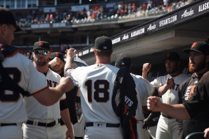 San Francisco Giants pitcher Matt Cain (18) walks back to the dugout after pregame workouts before their game against the San Diego Padres at AT&T Park on Saturday, September 30, 2017.