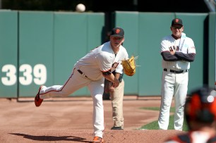 San Francisco Giants pitcher Matt Cain (18) warms up for the game against the San Diego Padres at AT&T Park on Saturday, September 30, 2017.