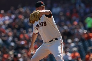 San Francisco Giants pitcher Matt Cain (18) pitches in the first inning as the San Diego Padres take on the San Francisco Giants at AT&T Park on Saturday, September 30, 2017.