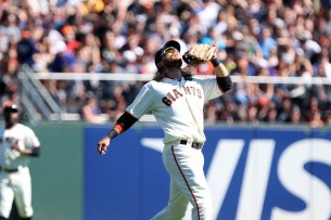 San Francisco Giants short stop Brandon Crawford (35) looks at a fly ball in the fourth inning as the San Diego Padres take on the San Francisco Giants at AT&T Park on Saturday, September 30, 2017.