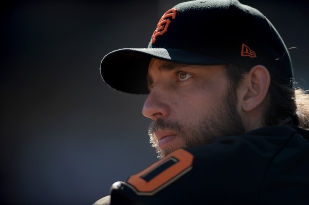 San Francisco Giants starting pitcher Madison Bumgarner (40) looks up at the scoreboard in the eighth inning as the San Diego Padres face the San Francisco Giants at AT&T Park in San Francisco, Calif., on Sunday, October 1, 2017.