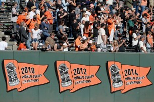 Fans watch the post game speeches on the screen after the last game of the 2017 season at AT&T Park in San Francisco, Calif., on Sunday, October 1, 2017.