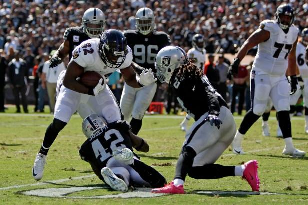 Oakland Raiders safety Karl Joseph (42) tackles Baltimore Ravens tight end Benjamin Watson (82) as the Baltimore Ravens take on the Oakland Raiders at the Oakland Coliseum on Sunday, October 8, 2017. The Ravens won 30-17.