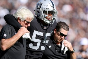Oakland Raiders linebacker Marquel Lee (55) gets carries off the field after an injury in the third quarter as the Baltimore Ravens take on the Oakland Raiders at the Oakland Coliseum on Sunday, October 8, 2017. The Ravens won 30-17.