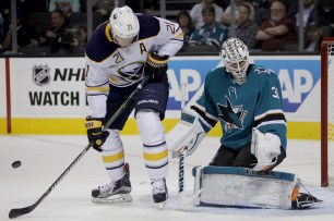 San Jose Sharks Martin Jones (31) and Buffalo Sabres Kyle Okposo (21) react to a shot on goal in the first period as the Buffalo Sabres take on the San Jose Sharks at the SAP Center in San Jose, Calif., on Thursday, October 12, 2017.