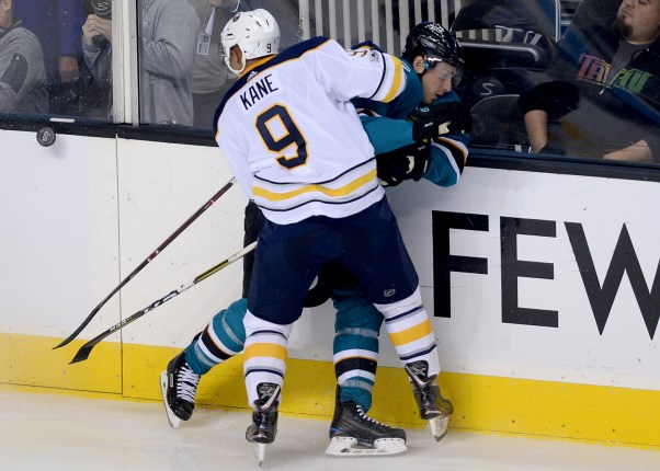 San Jose Sharks Justin Braun (61) is hit by Buffalo Sabres Evander Kane (9) in the second period as the Buffalo Sabres take on the San Jose Sharks at the SAP Center in San Jose, Calif., on Thursday, October 12, 2017.