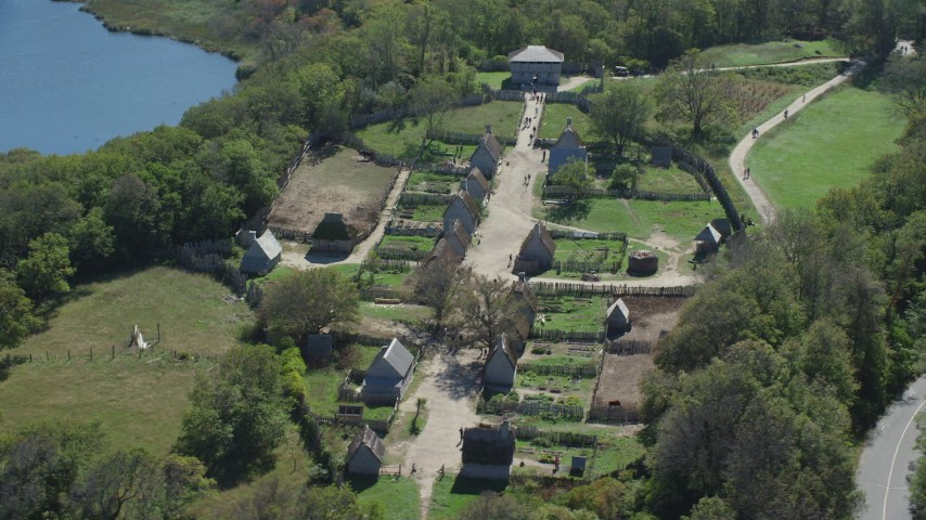 6K aerial video orbiting Plimoth Plantation. revealing body of water. Plymouth. Massachusetts Aerial Stock Footage AX143_108