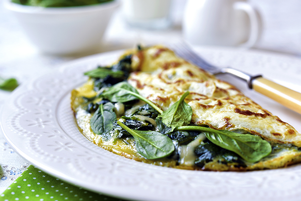 Omelette stuffed with spinach and cheese
