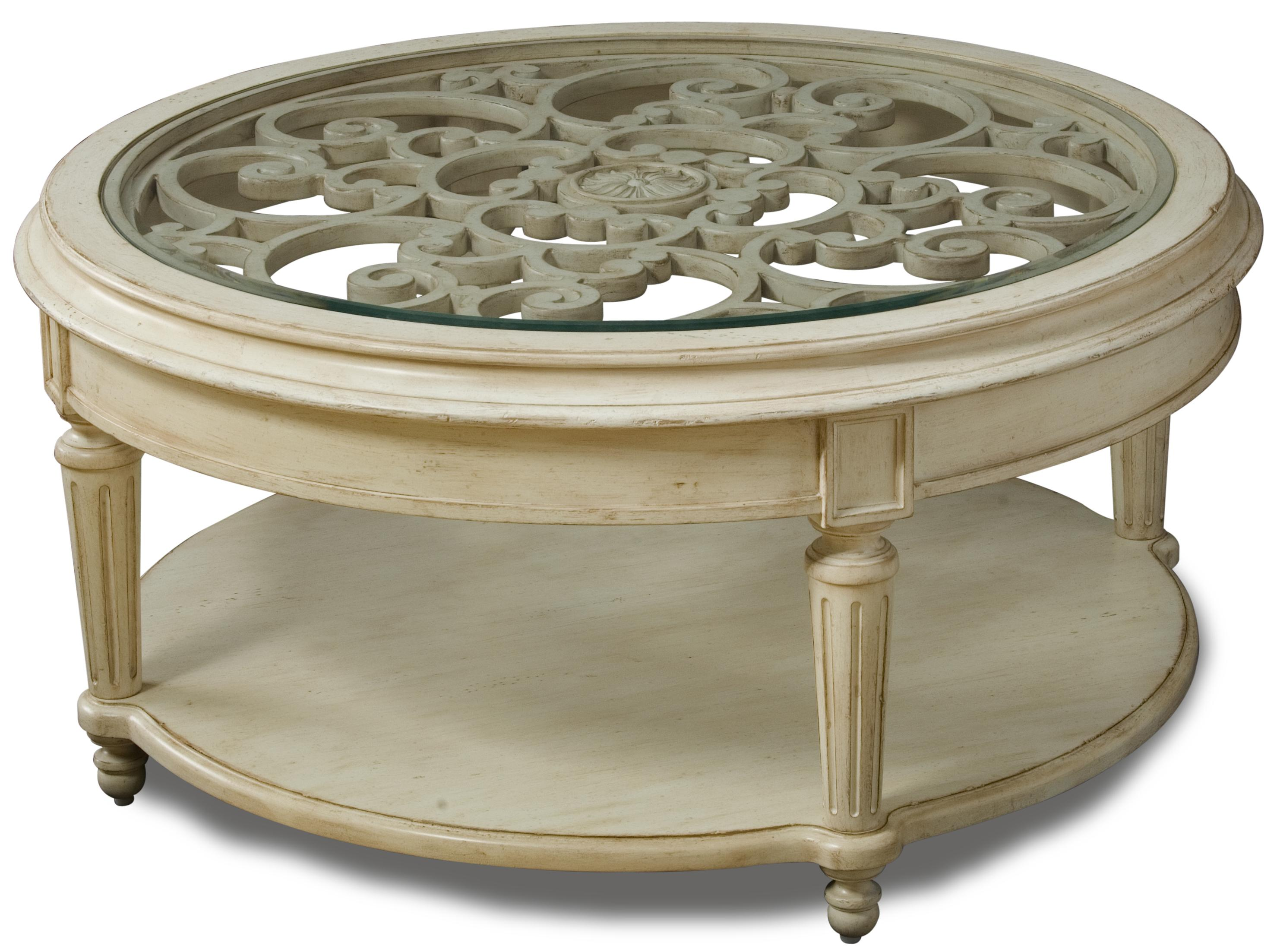 Carved Round Cocktail Table with Glass Top by A.R.T