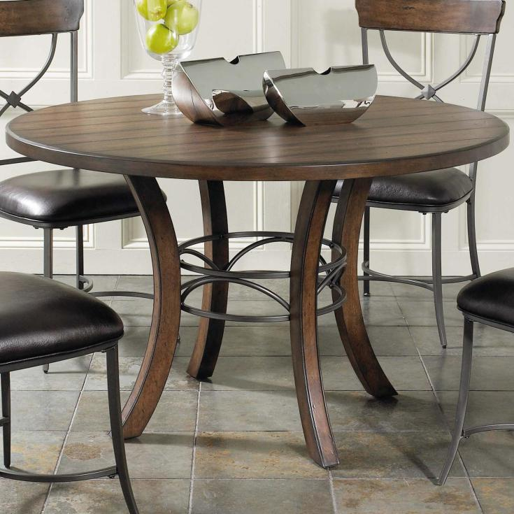 round wood dining table with metal acent base by hillsdale | wolf