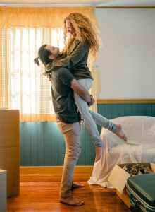 cheerful boyfriend lifting girlfriend up