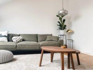 gray 2 seat sofa near brown wooden coffee table
