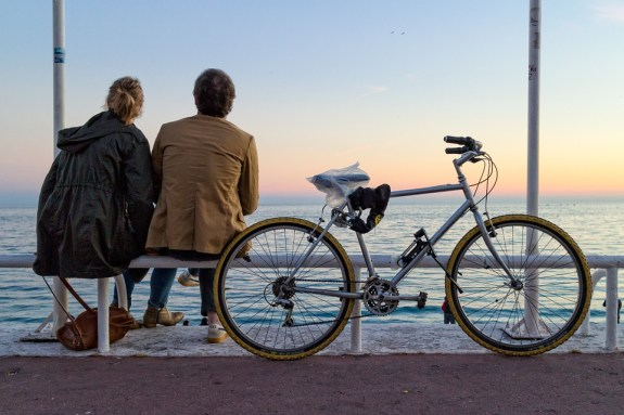 Couple on Nice waterfront, France