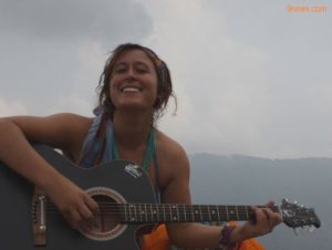 Aubrey Sacco, pictured playing her guitar