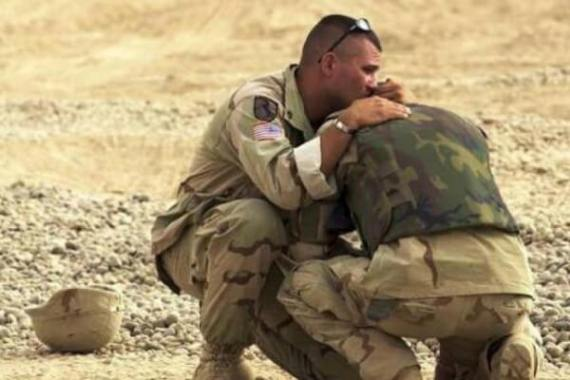soldiers comforting each other on the battlefield