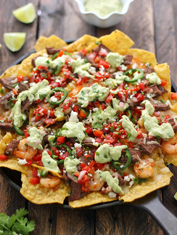Grilled Surf 'n Turf Party Nachos with Avocado Cotija Sauce and Margarita Pico de Gallo from SoupAddict.com