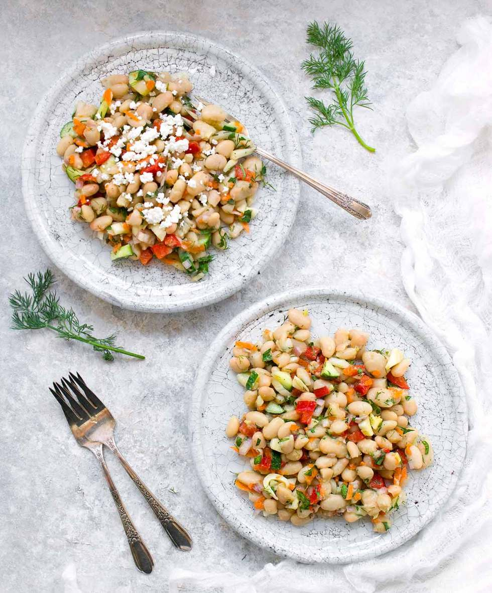 Herbed White Bean Picnic Salad, with or without goat cheese topping. Recipe at SoupAddict.com
