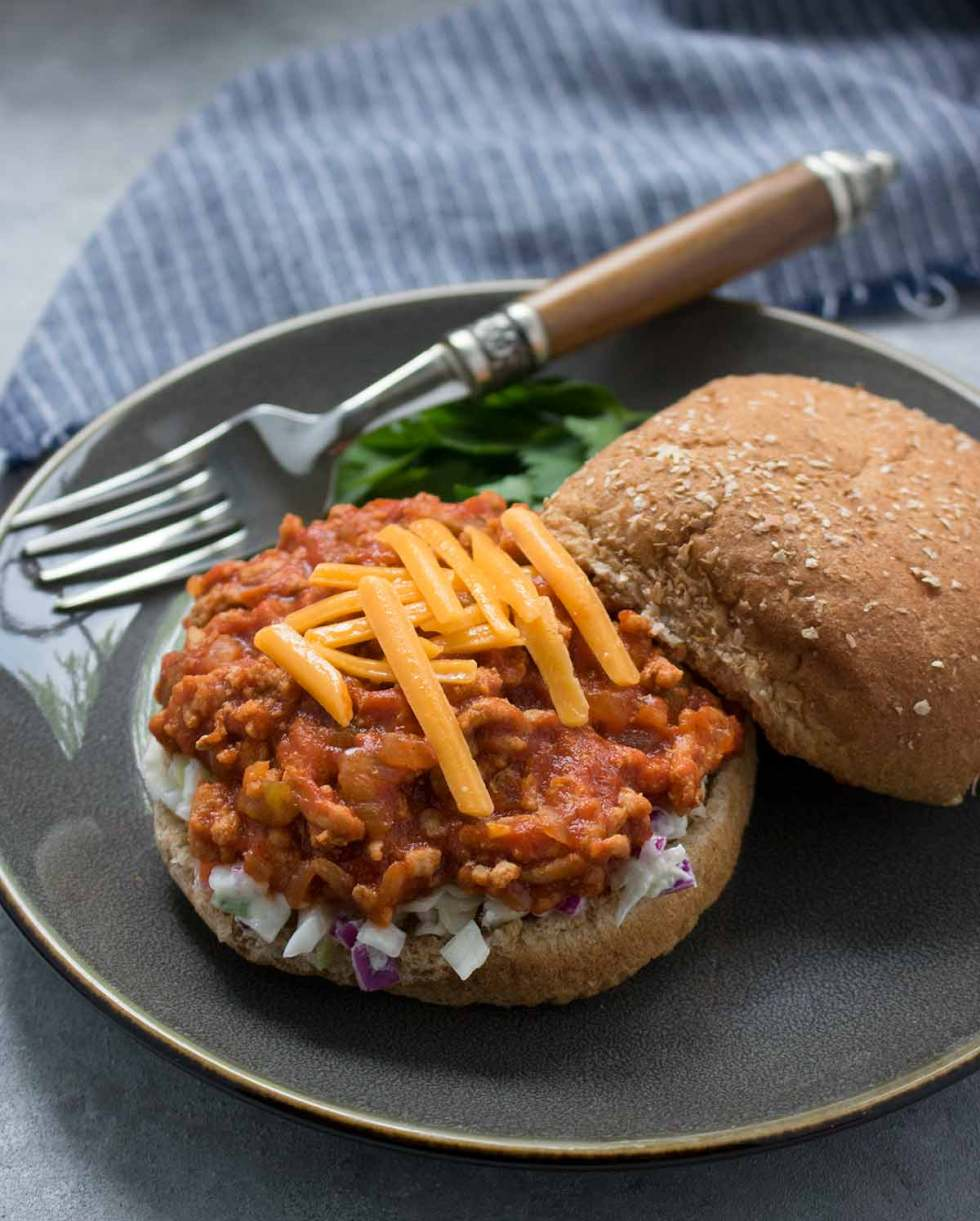 Healthy and delish Turkey Sloppy Joes with cheese and coleslaw, ready to eat! Recipe at SoupAddict.com