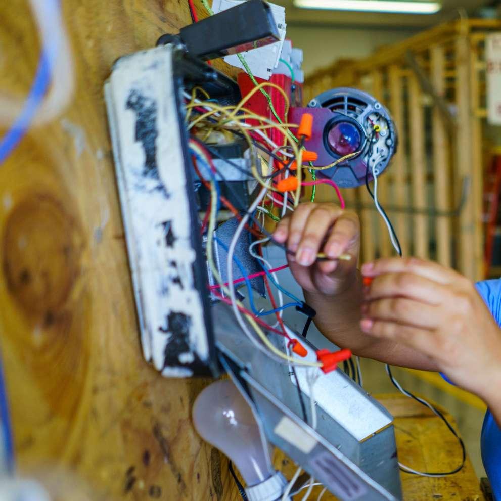 an electrician checks wiring [ 991 x 991 Pixel ]