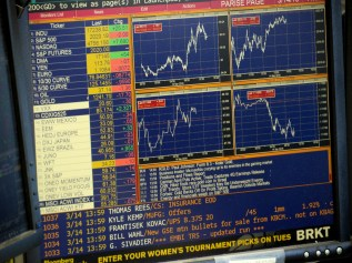 This digital version of the old stock market ticker is one of many screens used to follow economic trends at the Alaska Permanent Fund Corp. (Photo by Skip Gray/360 North)