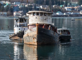 The tug Challenger is towed to the beach to be demolished on March 7, 2016 (Photo by David Purdy/KTOO)