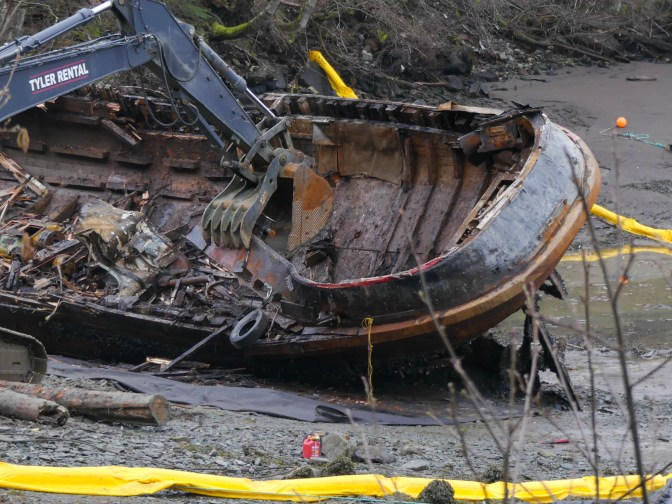 Excavators demolish the tug Challenger on March 8, 2016 (Photo by David Purdy/KTOO)
