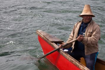 Doug Chilton, head of the One People Canoe Society skippers a canoe commemorating Alaska Native veterans on Wednesday, June 8, 2016, near Juneau, Alaska. The society began the trip on June 2. Their landing on Douglas Island is the unofficial beginning of Celebration. (Photo by Rashah McChesney/KTOO)