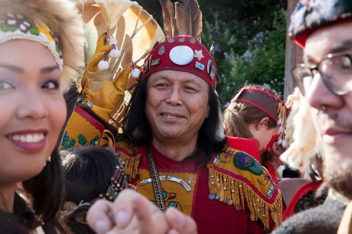 Fausto Paulo, from the Humpback Moon house in Yakutat waits for his group's turn to march during a processional and grand entrance on Wednesday, June 8, 2016, near Juneau, Alaska. Celebration is a biennial festival of Tlingit, Haida and Tsimshian tribal members put on by the Sealaska Heritage Institute. (Photo by Rashah McChesney/KTOO)