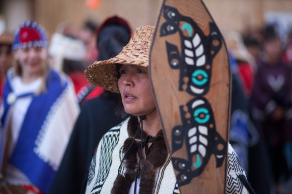 Hundreds gather to march during a processional and grand entrance on Wednesday, June 8, 2016, near Juneau, Alaska. Celebration is a biennial festival of Tlingit, Haida and Tsimshian tribal members put on by the Sealaska Heritage Institute. (Photo by Rashah McChesney/KTOO)